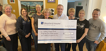 Woodland staff donate to local community cafe